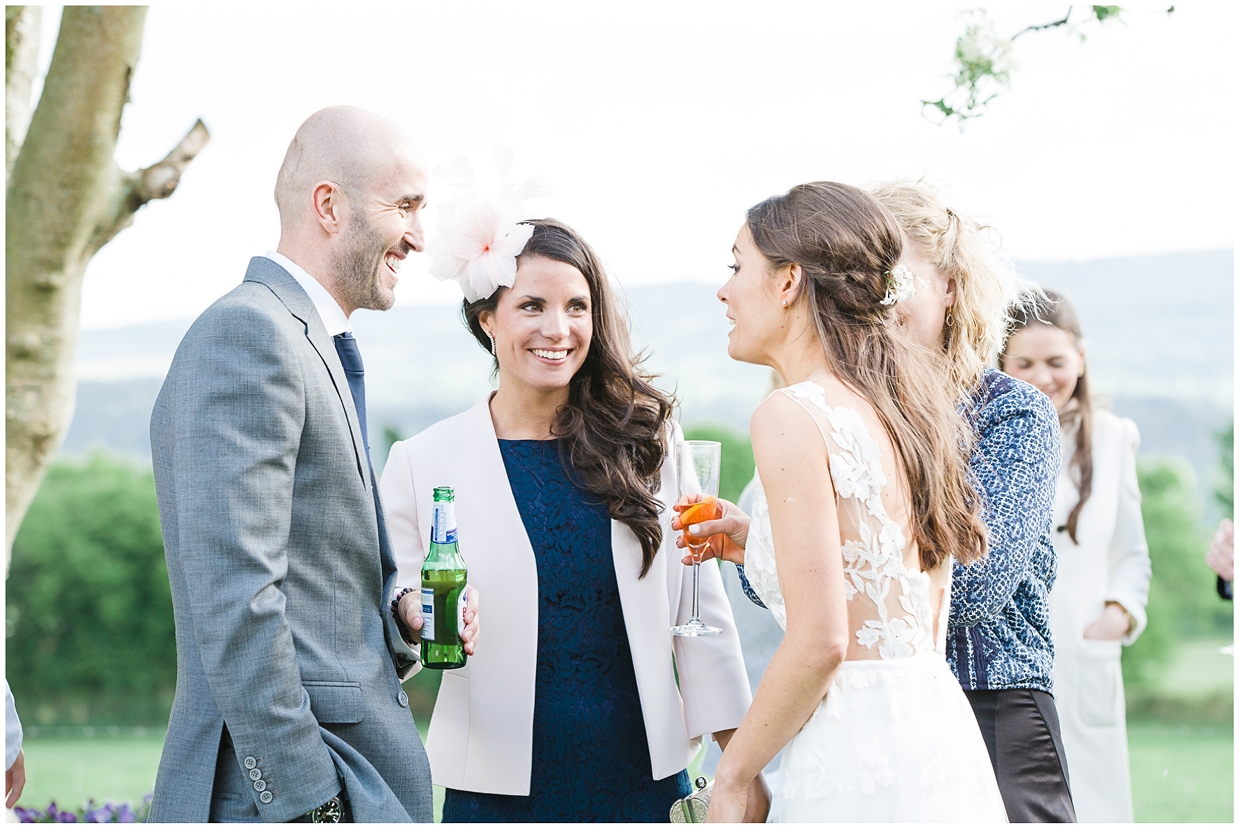 wedding guests during drinks reception with bride