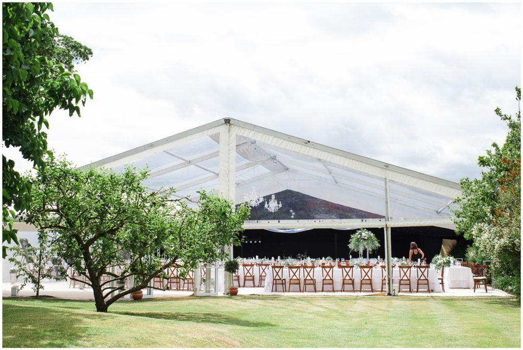 Garden marquee wedding set up. Clear marquee in the family garden.