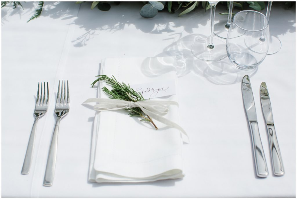 Brides place setting, rosemary and ribbon around napkin.