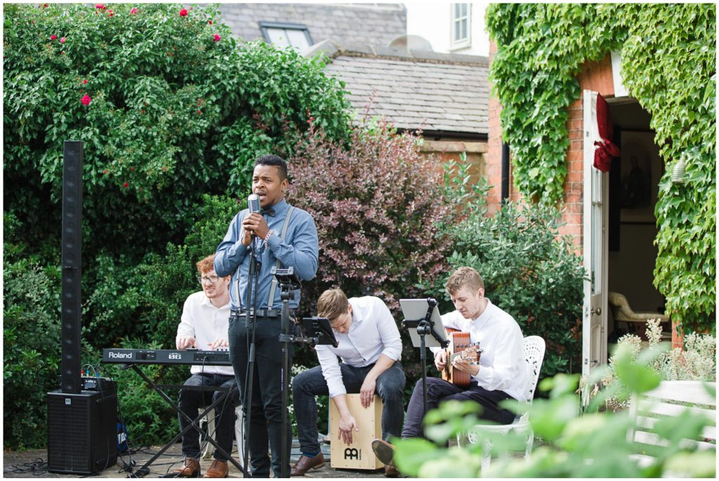 Singer and band performing during drinks reception.