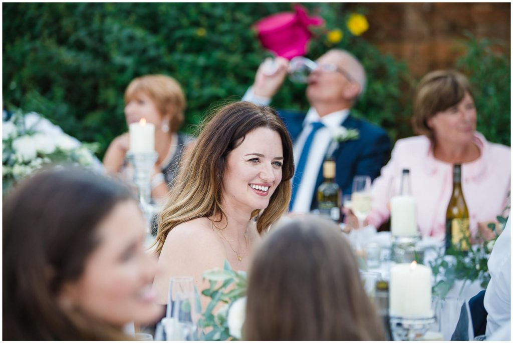Wedding guest laughing during wedding breakfast
