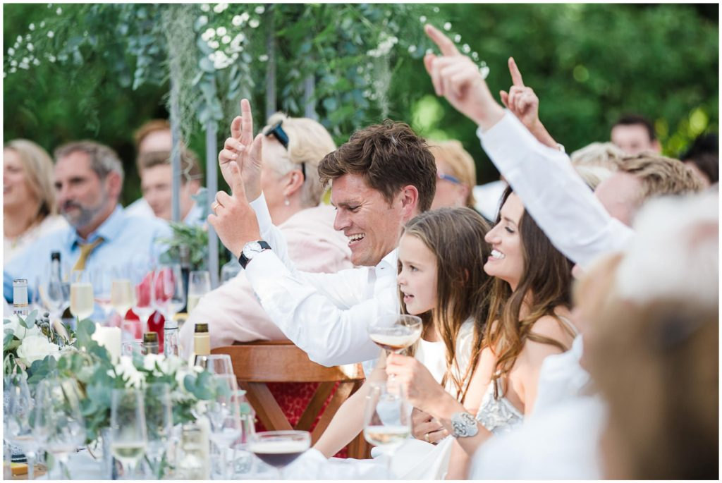 Wedding guests cheering during speeches