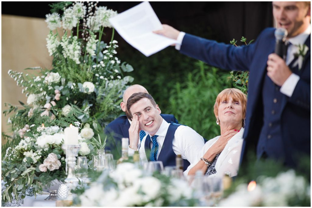 Best man laughing during grooms speech