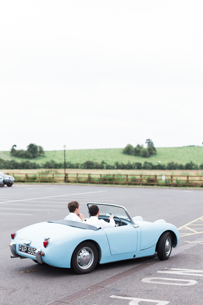 groom arriving in vintage car