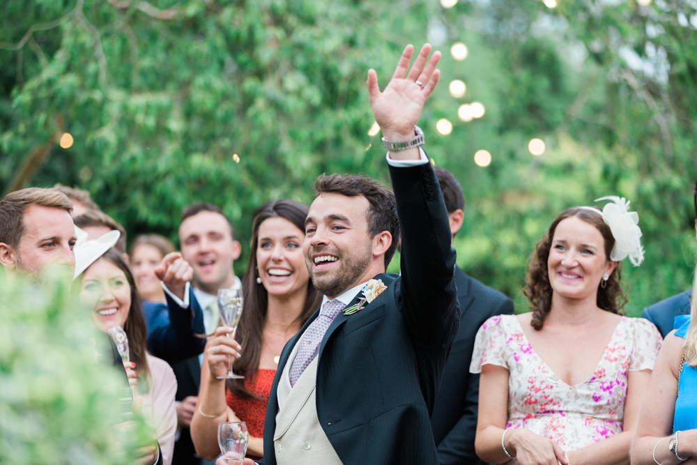 groom waving