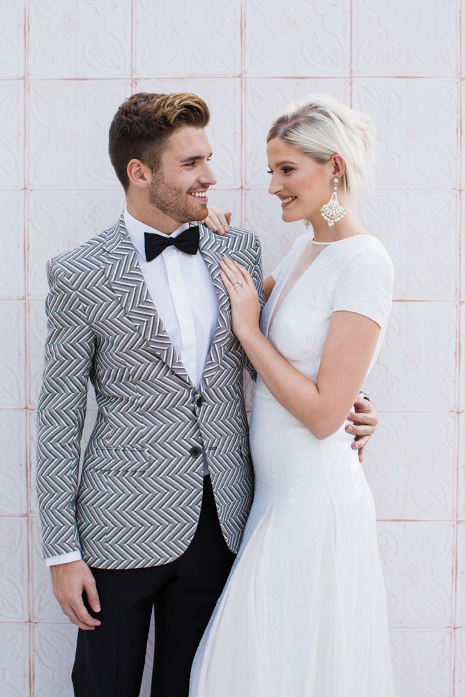 Bride and groom smiling to each other