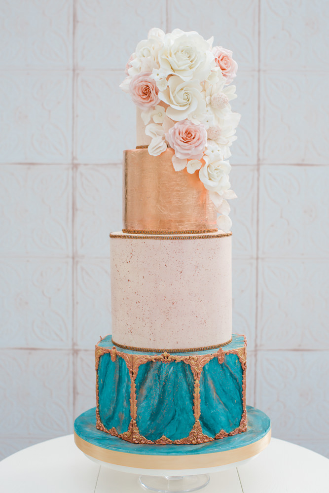 Decadent wedding cake with floral top tier