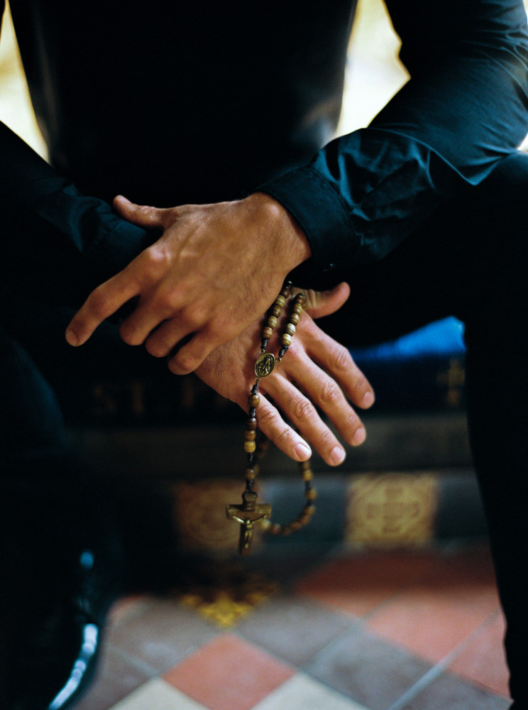 Groom holding rosemary beads