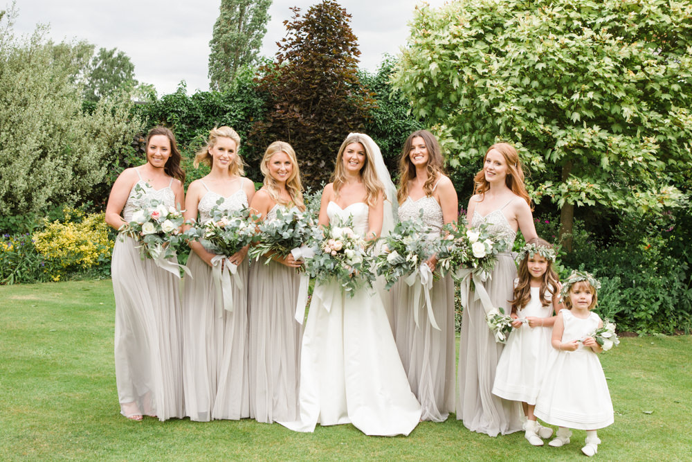 Bride with bridesmaids in the garden