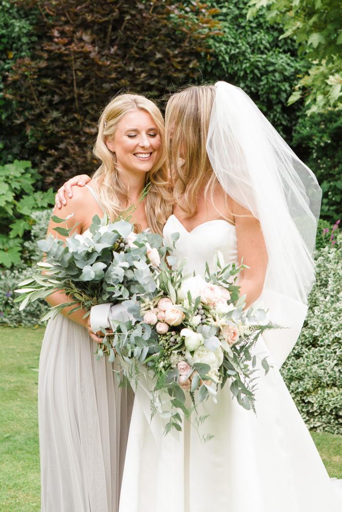 Bride hugging her sister