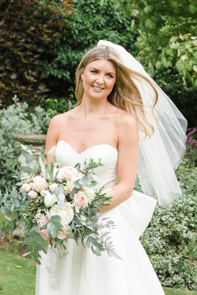 Bride holding her bouquet and smiling