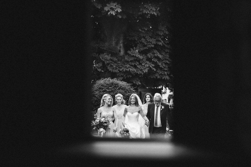 Bridal party walking to the church