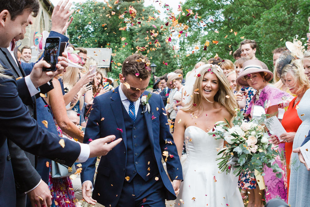 Bride and groom confetti throwing