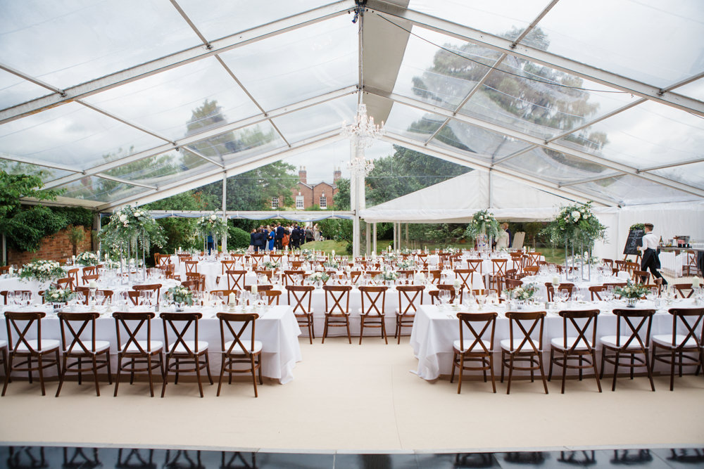 Clear marquee interior ready for wedding breakfast