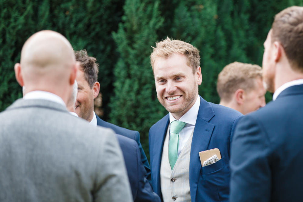 Wedding guest laughing in drinks reception
