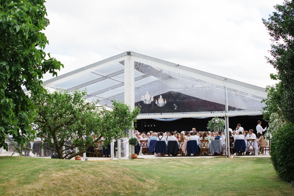 Clear marquee with guests seated