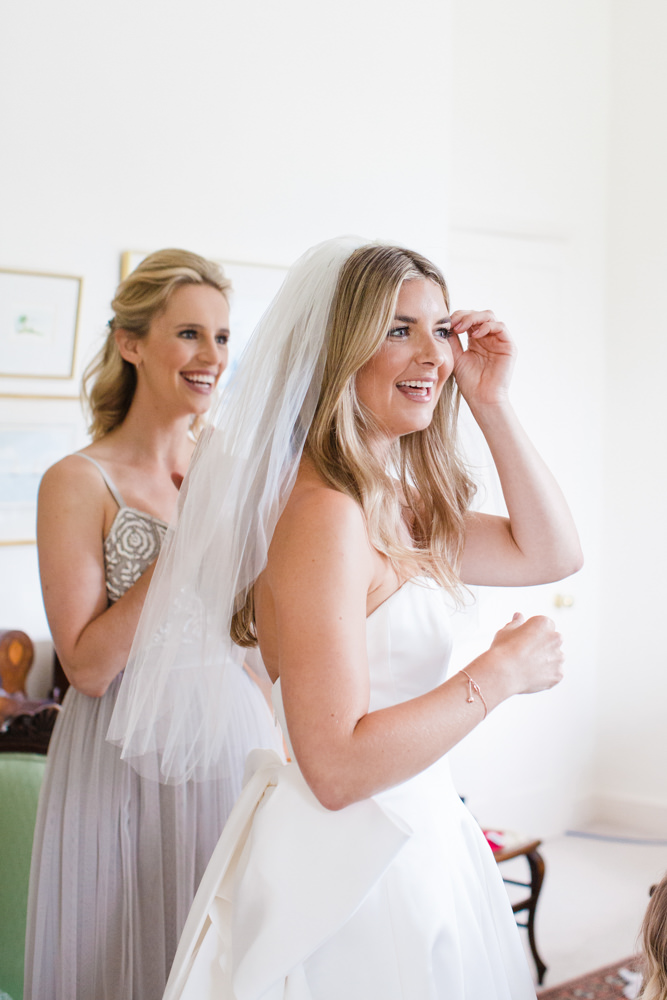 Bride smiling in veil