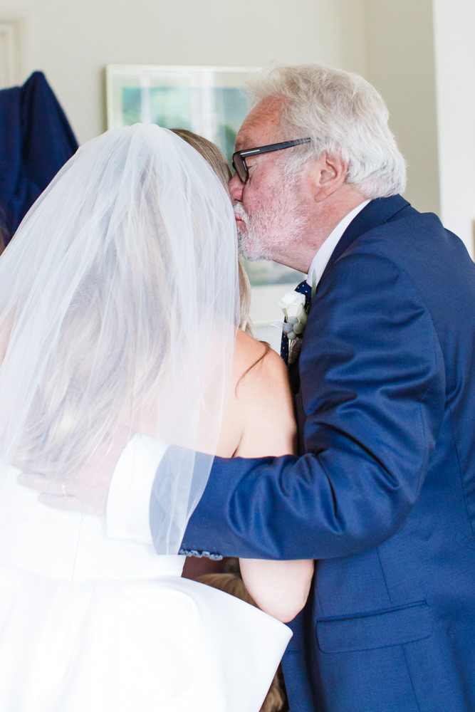 Bride being kissed by her father