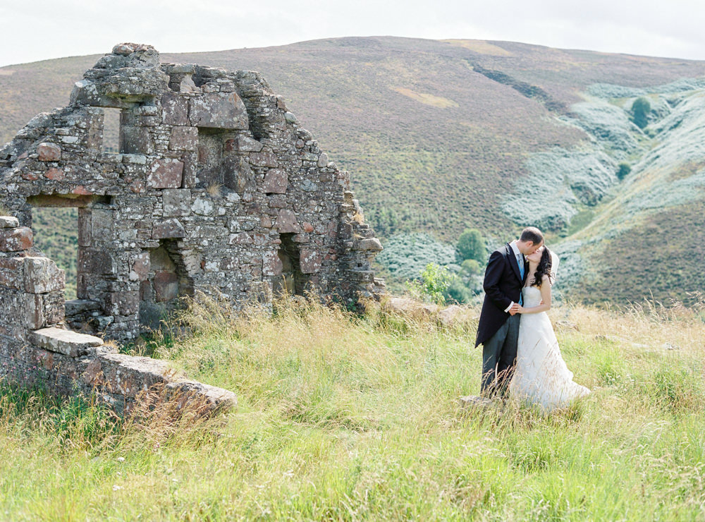 Bride and groom at ruins in highlands