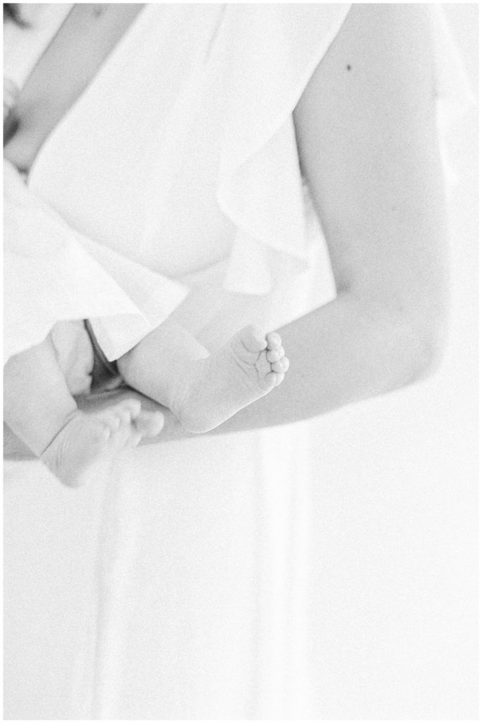Newborn studio photography London, black and white baby feet