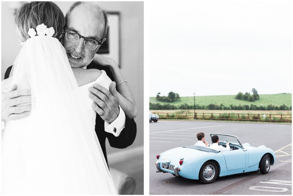 Father of the bride hugging the bride. Groom arriving in vintage car.