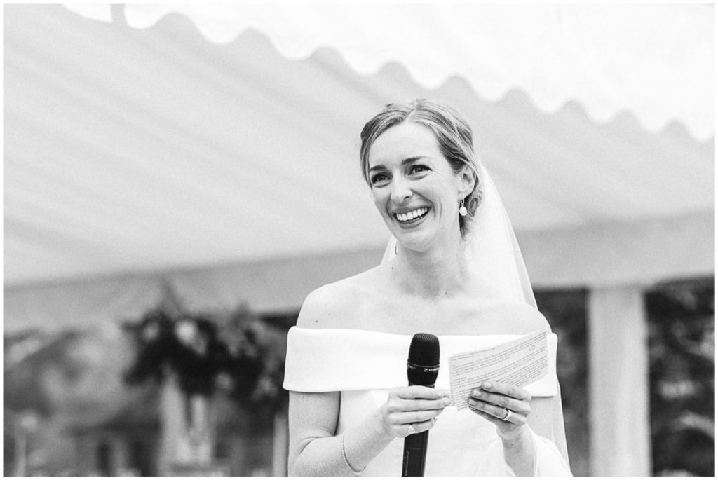 Bride giving a speech outdoors