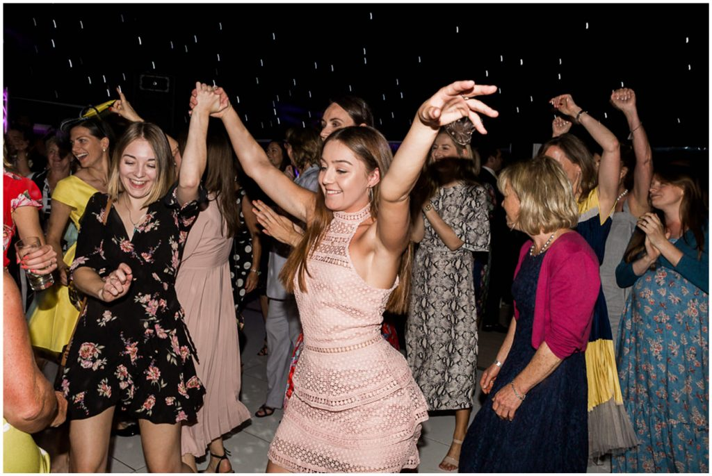 Wedding guests dancing, marquee wedding