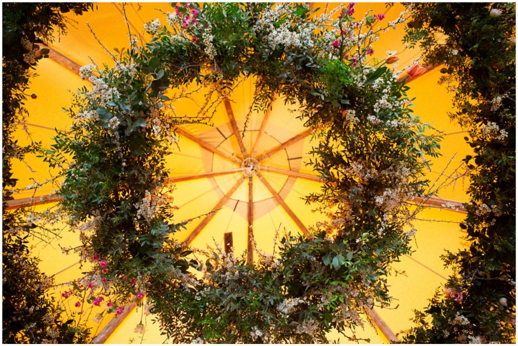 PapaKata wedding, giant floral hoop suspended from top of tipi tent