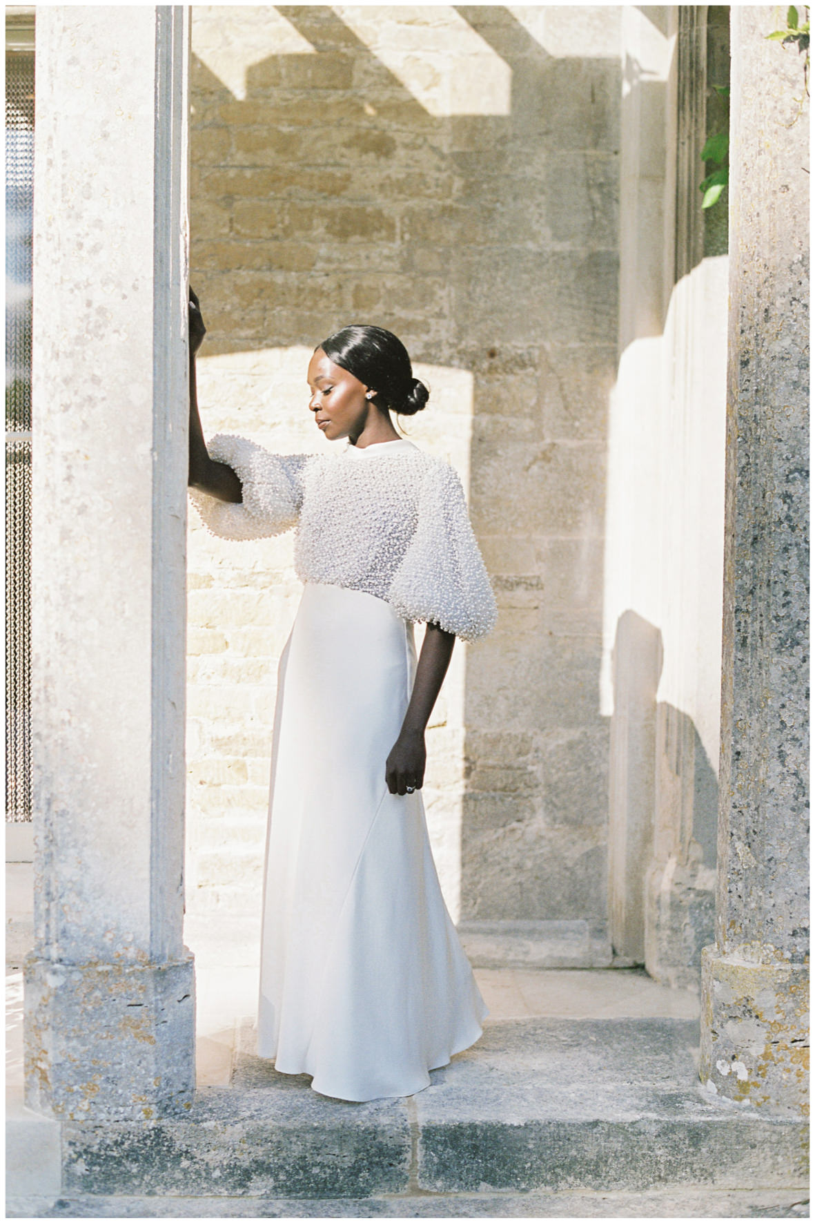 Bride wearing Romancera Madrid beaded wedding dress at Barnsley House.