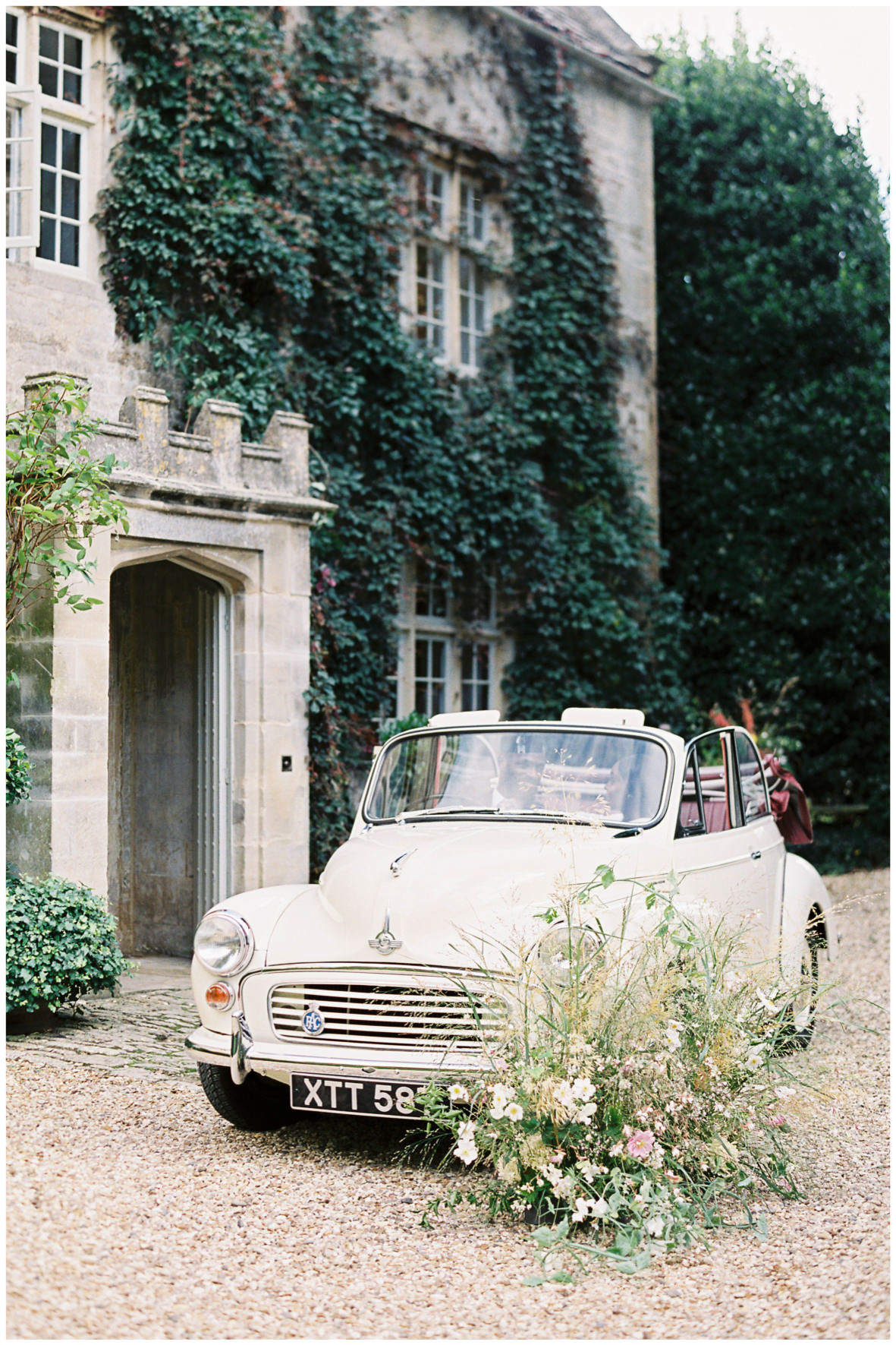 Convertible wedding car, with florals by Vervain at Barnsley House.