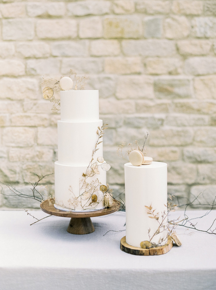 Very Vanilla understated wedding cakes with macaroon details.